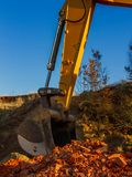 A large yellow excavator on a construction site. royalty free stock photo