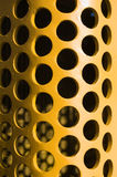 Large Yellow hole pattern curved plate Stock Image