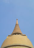 Large yellow and old pagoda with a beautiful sky clouds background Stock Images