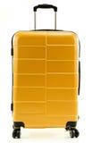 Large yellow polycarbonate suitcase on white Royalty Free Stock Photo