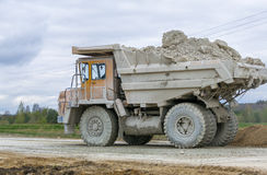 Large-yellow quarry dump trucks produce transportation of minerals Royalty Free Stock Image