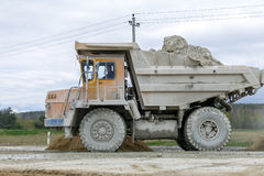 Large-yellow quarry dump trucks produce transportation of minerals Stock Image