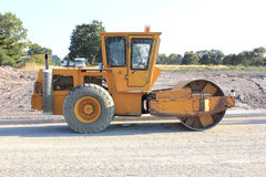 Large yellow road rolling machine Stock Photo