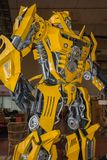 Large Yellow Robot Built with Automobile Parts.  stock images