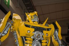 Large Yellow Robot Built with Automobile Parts. Parma, Italy - March 2018: Large Yellow Robot Built with Automobile Parts royalty free stock images