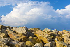 Large yellow stones with blue clouds. Yellow stones with blue clouds royalty free stock photo