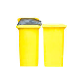 Large yellow trash can Royalty Free Stock Images