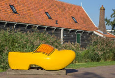 Large yellow wooden shoe in Zaanse Schans. Holland royalty free stock images