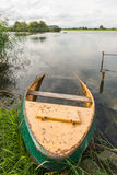 Largely sunken rowboat in the foreground Royalty Free Stock Image