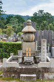 Larger family grave at Japanese cemetery. Kyoto, Japan - September 15, 2016: Adjacent to the Shinnyo-do Buddhist Temple is a large cemetery serving the Buddhist stock photos