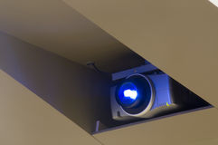 Larger Projector. In Ceiling with Blue Light at College Auditorium stock image