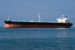 Larger tanker ship. A large chemical tanker ship prepares to leave a harbor Stock Images
