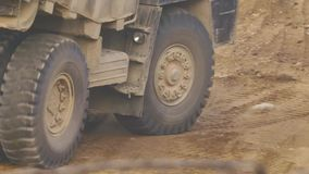 Larger truck wheels. Large wheels of the truck in the sandy quarry stock video footage