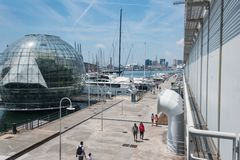 The largest Aquarium in Europe. On the left side - biosphere green house. The old harbour in Genoa, Porto Antico and The largest Aquarium in Europe. On the left royalty free stock image