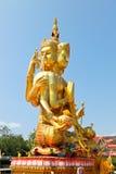Largest brahma statue against blue sky at Wat Samaesan. Stock Image