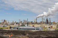 Huge oil refinery plant with smoked pipes Stock Photo