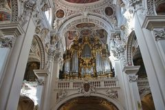 The largest cathedral organ in the world, St. Stephen`s cathedral, Passau, Germany. Passau, Bavaria, Germany - February 23, 2019: Nave in St Stephen's royalty free stock photos