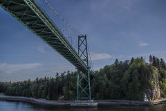 Cruise Ship Passes under Lions Gate Bridge in Historical Crossing royalty free stock photo