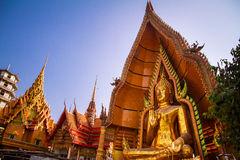 The largest golden Buddha with blue sky as a backdrop. Stock Photo