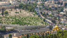 Largest Jewish cemetery in the world on slopes timelapse of Mount of Olives, Jerusalem, Israel. Traffic on the road and Orthodox Church stock video footage