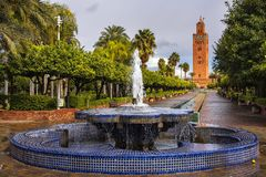 Amazing view of Koutoubia Mosque in Marrakech in Morocco. The largest, and the most beautiful mosque in Marrakesh, the Koutoubia Mosque with the fountains the stock photo