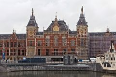 AMSTERDAM, NETHERLANDS - JUNE 25, 2017: Amsterdam Centraal station building. Is the largest railway station of city and a major national railway hub. Was Stock Images