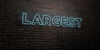 LARGEST -Realistic Neon Sign on Brick Wall background - 3D rendered royalty free stock image Stock Photos