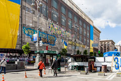 Largest Ukrainian flag posted in building of central universal s Stock Photo