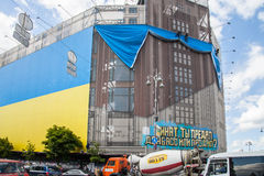 Largest Ukrainian flag posted in building of central universal s Royalty Free Stock Photo