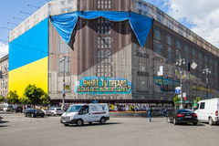Largest Ukrainian flag posted in building of central universal s Royalty Free Stock Photos