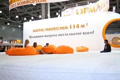 Largest in the world mattress. MOSCOW-May 18: Largest in the world mattress at the international exhibition of professional furniture EEM Euroexpofurniture on Stock Photos