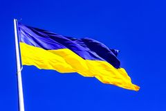 The largest yellow - blue state flag of Ukraine on the flagpole 30 meters in the Ukrainian Dnepr city. Dnepropetrovsk, Dnipropetrovsk, Dnipro stock photos