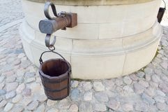 Largewa round old ancient stone well with buckets for ter.  stock photos