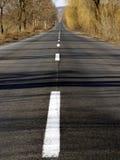 Largo camino Imagen de archivo libre de regalías