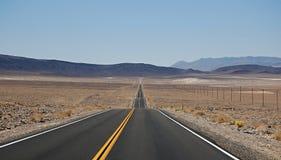 Largo camino Foto de archivo libre de regalías