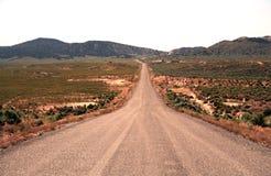Largo camino a continuación Fotografía de archivo libre de regalías