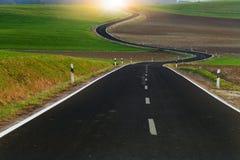 Largo camino del enrollamiento Imagen de archivo