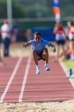 Largo-Salto del joven del atletismo Imagen de archivo libre de regalías