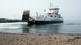 A Scottish car ferry coming into the largs pier stock video footage