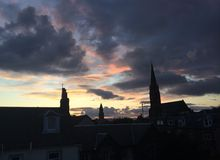 Largs silhouette. Church clouds night Stock Image