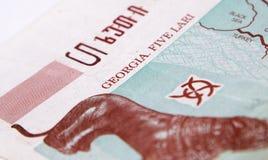 Lari géorgien d'argent sur le blanc image stock