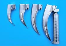 Laringoscopio de Macintosh con las cucharas del conjunto Imagen de archivo
