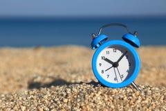 Αlarm clock on the beach Stock Images