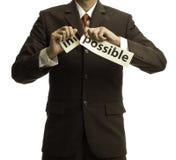 Larme asiatique d'homme d'affaires le papier pour le mot possible Image libre de droits