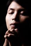 Larmes dans la prière Photos libres de droits
