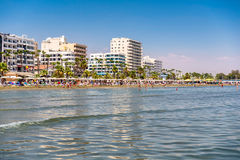 LARNACA, CYPRUS - AUGUST 27, 2016: Sea front, beach and high ris Stock Image