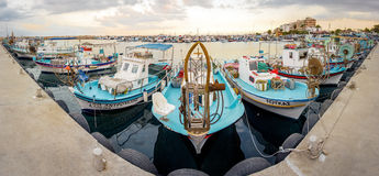 Larnaca fishing boats harbour. LARNACA, CYPRUS - JUNE 1, 2014: Larnaca fishing boats harbour on June 1, 2014. Fish in Cyprus waters are small because waters lack Stock Photos