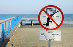 Larnaca Phinikoudes beach with red no jumping warning sign,Cyprus Royalty Free Stock Photography