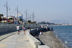 Larnaca seafront with palm trees , pedestrians and beach,Cyprus Stock Image