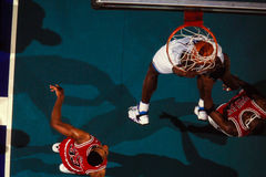 Larry Johnson dunks against Horace Grant. Stock Photo